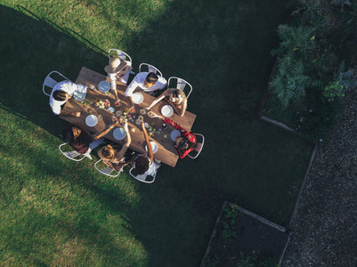 Aerial view of friends toasting drinks