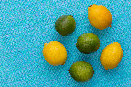 Lemon and lime on bright blue background