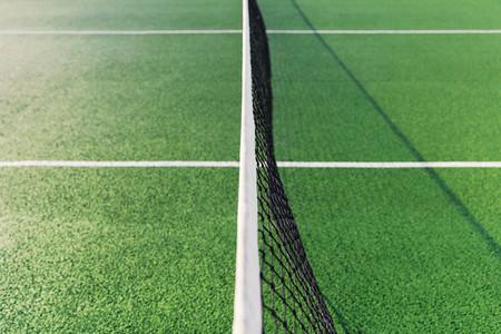Net on green tennis court