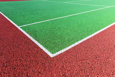 Baseline on green hard tennis court