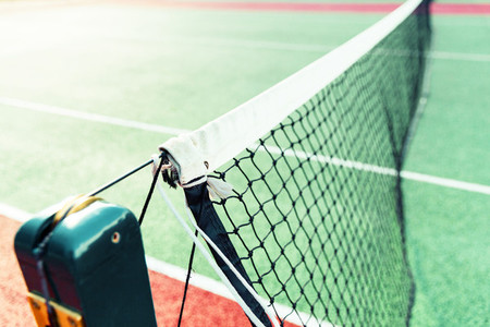 Tennis court net in sunlight