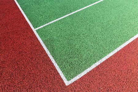 Baseline on green tennis court