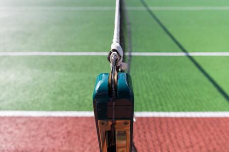 Central net on green tennis court