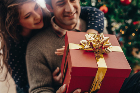 Young couple with a Christmas gift box