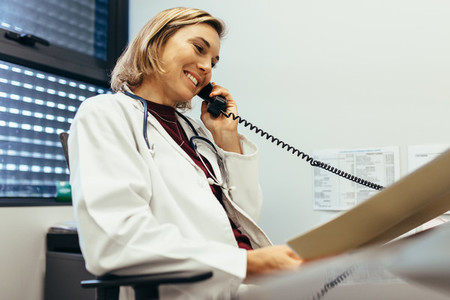Female physician working at her office desk