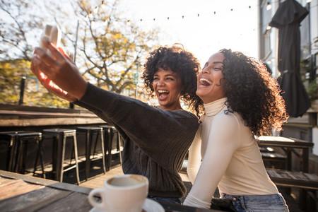 Two young women having fun taking a selfie