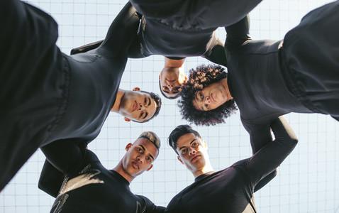 Five a side football team huddle