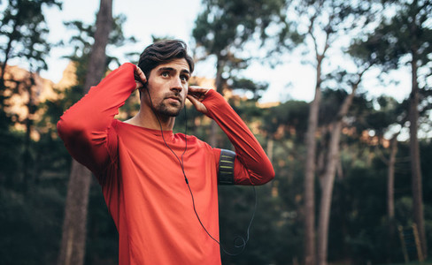 Runner wearing earphones during workout