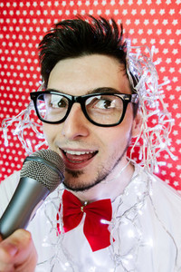 Young man singing at a party