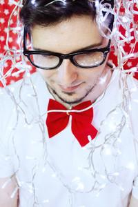 Young man and christmas lights