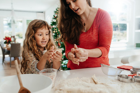 Mother and daughter preparing Christmas cookies