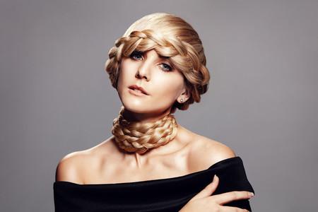 Beautiful young woman with creative braid hairdo