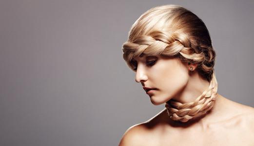 Blond woman with creative braid hairdo
