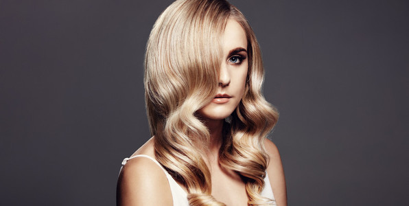 Elegant blonde with shiny hair and beautiful skin