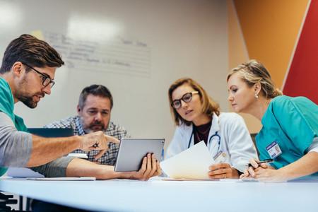 Healthcare workers having a meeting in boardroom