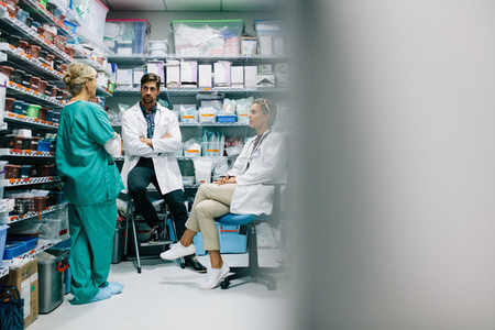 Hospital staff discussing medication in the pharmacy
