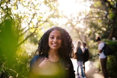 Smiling woman walking in park