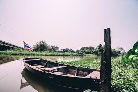 Thai boat docked in the river
