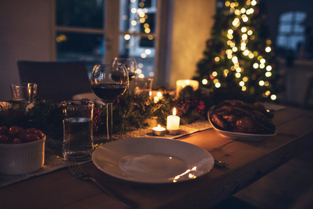 Festive christmas table place setting at home