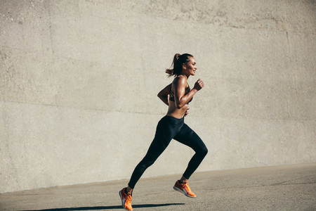 Healthy young woman on morning run