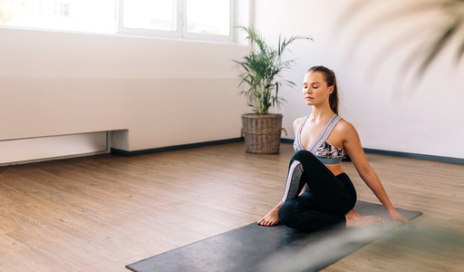 Healthy woman doing yoga indoors