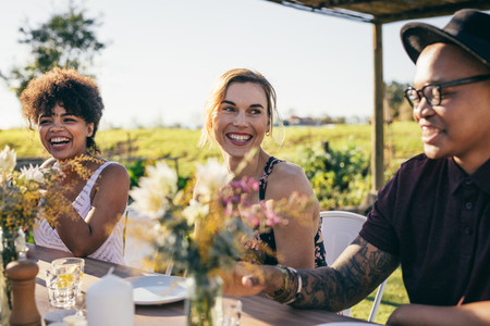 Group of friends enjoying meal at outdoor party