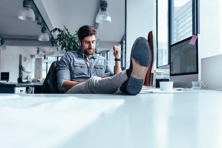 Businessman relaxing in office during break