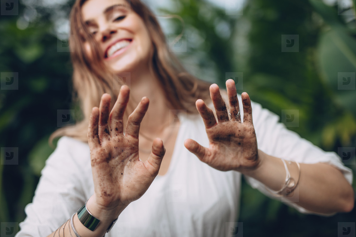 Female gardener showing her dirty hands