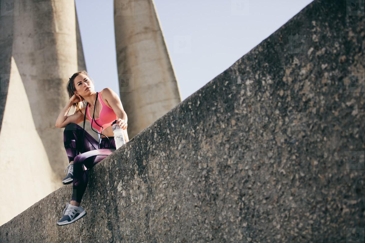 Female athlete taking a break after exercising