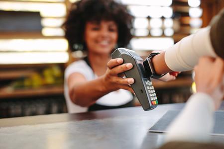 Customer paying bill using a smartwatch