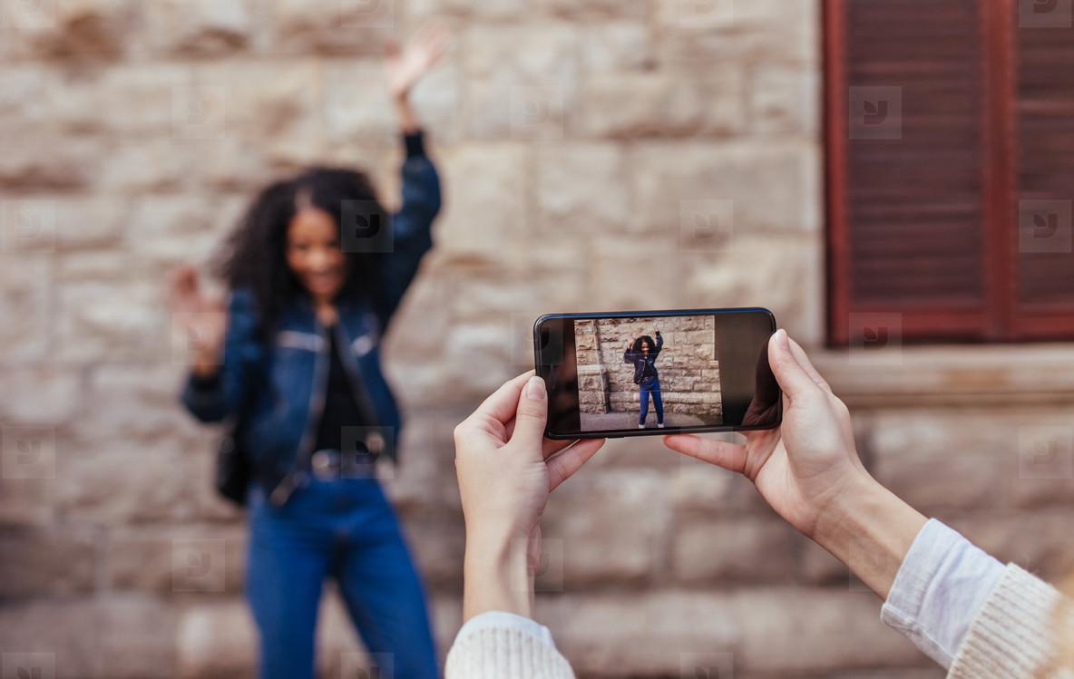 Woman posing for photos outdoors