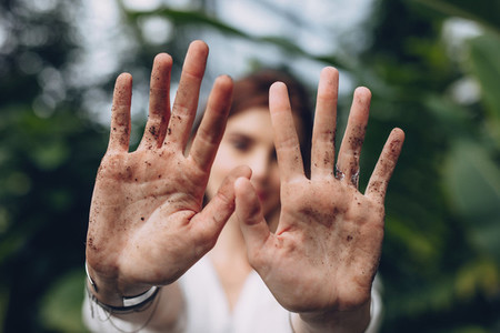 Woman hands after garden work and landscaping