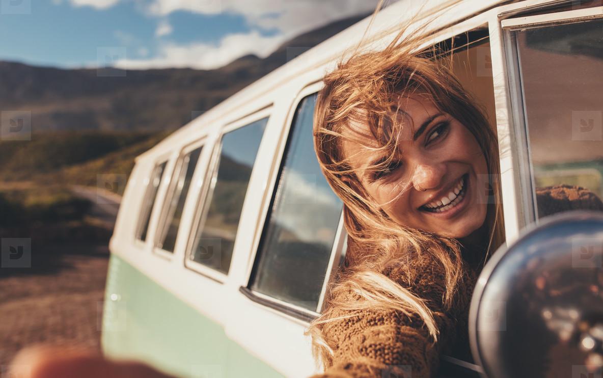 Woman enjoying on the road trip