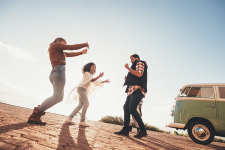 Group of friends having fun together on roadtrip