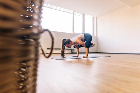 Woman doing crane yoga pose