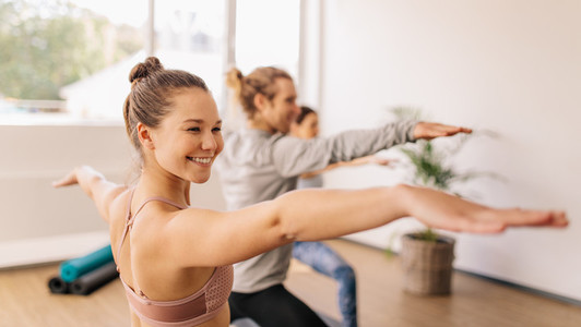 Woman practicing yoga at gym class