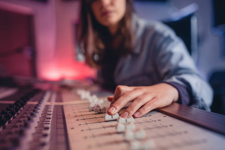Woman hands working on music mixer