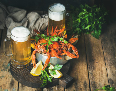 Wheat beer and boiled crayfish with lemon fresh parsley