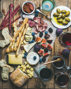 Wine and snack set with wines  meat  bread  olives  fruits