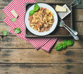 Tagliatelle Bolognese with Parmesan and Basil leaves  copy space