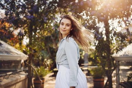 Woman fashion model at a garden