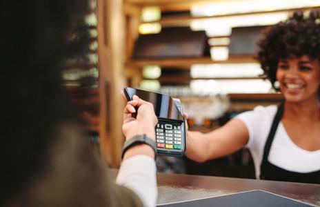 Customer paying bill using smartphone
