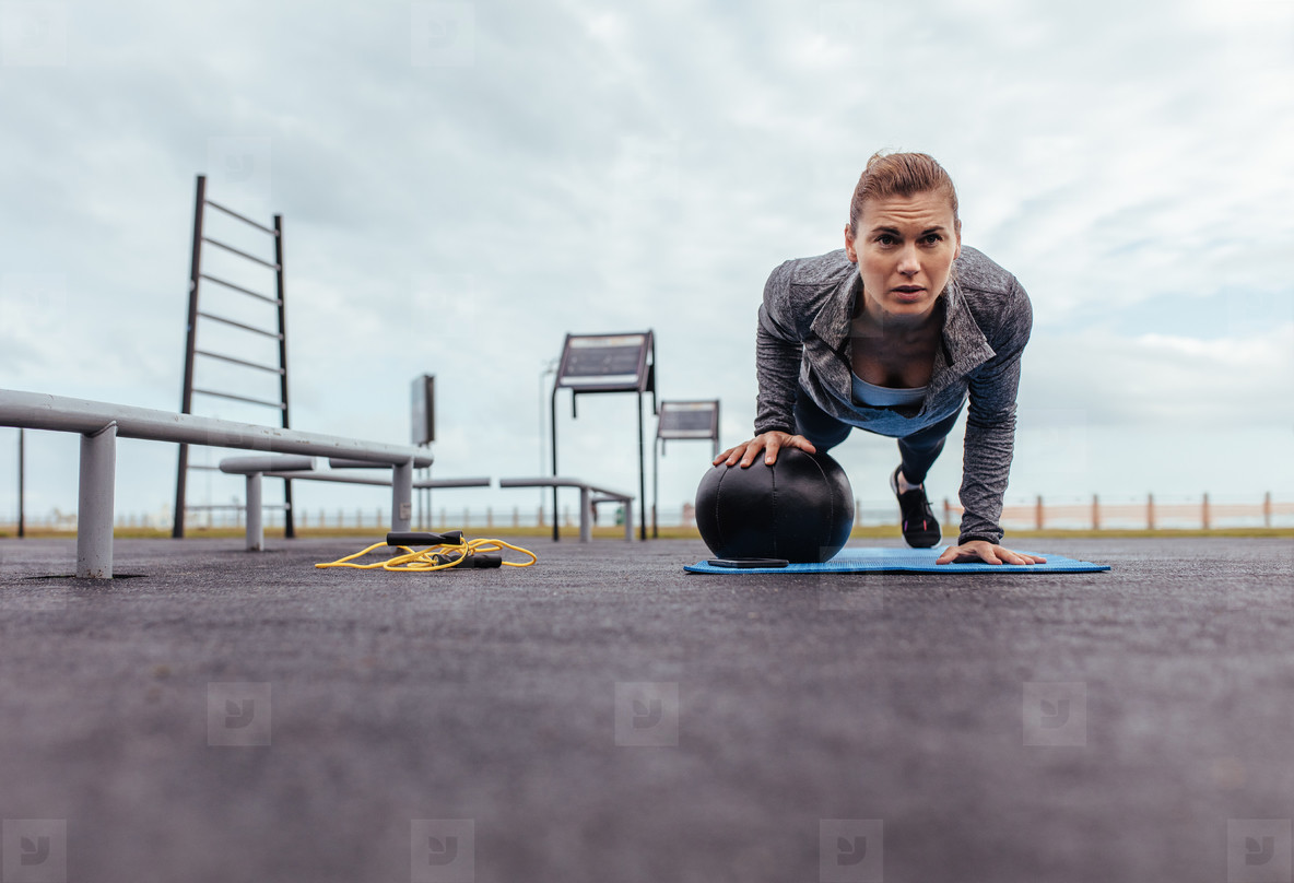 Young and fit sportswoman doing pushups