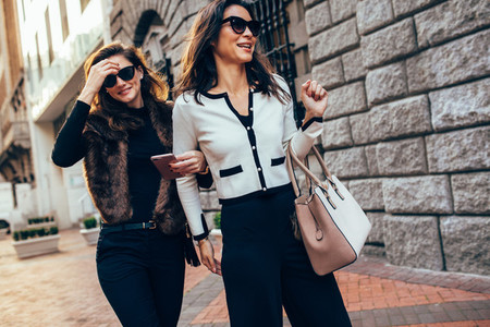 Two women walking together on the street