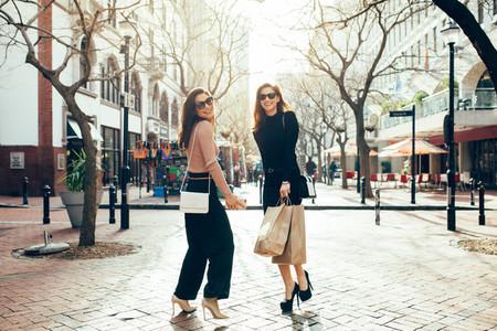 Beautiful women enjoying shopping in the city
