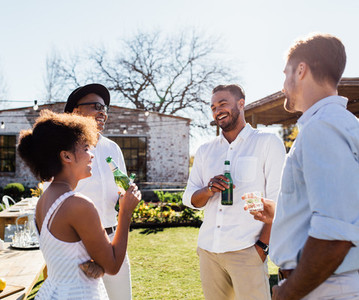 Cheerful group of friends having a party outdoors