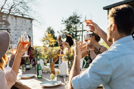 Friends toasting drinks at a garden restaurant