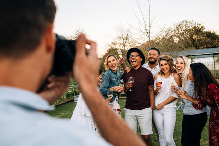 Group of people posing for a photograph at party