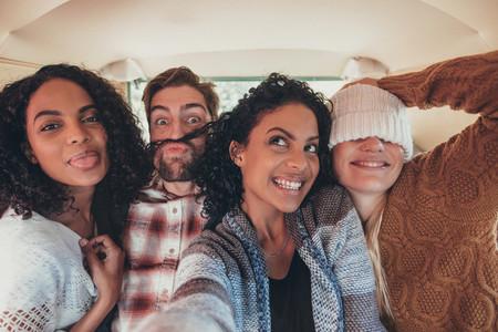 Friends taking selfie on road trip