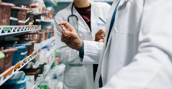 Two pharmacist looking for critical medicinal drug